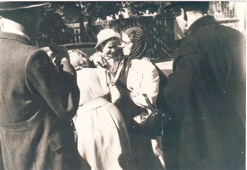 The  moment of departure from the orphanage. The Head Mother Aniela Szoździńska with Gitta in her arms.